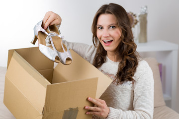 Woman unboxing her online order in the living room