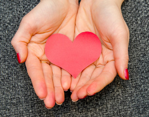 paper hearts on woman hand