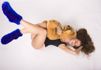 sexy young woman wearing pink shorts with a teddy bear