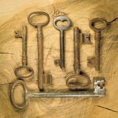Group of old rusty keys on wood