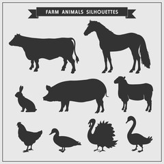 Silhouettes of farm animals isolated on a gray background.