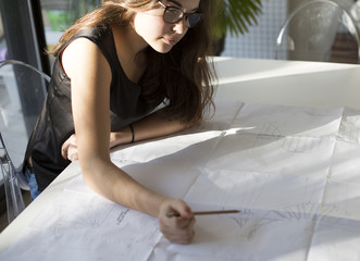 Female architect working at home - architecture series