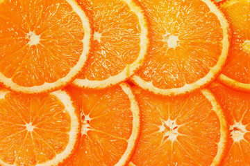 orange background chopped circle closeup oranges