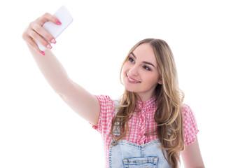 teenage girl making selfie photo on smart phone isolated on whit