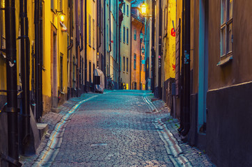 The narrow street of Gamla Stan - historic city old center of Stockholm, at summer night, with lanterns Fotomurales