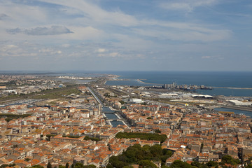 View over Sete. From an observation point on a local hill, the view out over Sete, a town on the Mediterranean in France is of a thriving coastal community.