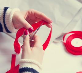 Woman cuts a red ribbon