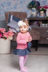 Adorable little girl in dress, crown of roses