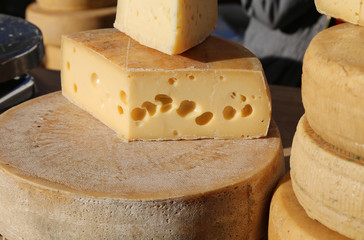 mature cheese with holes for sale in the market