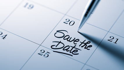 Obraz Closeup of a personal agenda setting an important date written w - fototapety do salonu
