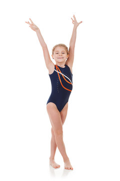 Gymnast: Young Girl With Hands Held Aloft