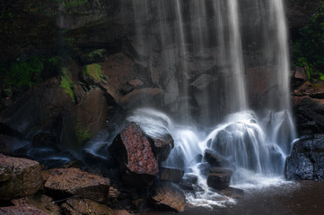 Wet stones and rocks of mountain river waterfall