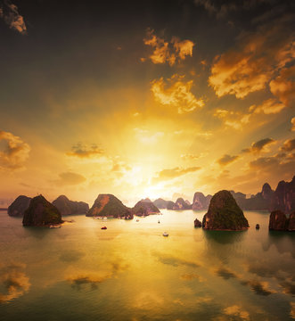 Sunset over the islands of Halong Bay in northern Vietnam. Amazing landscape background