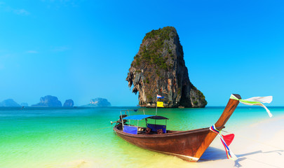 Wall Murals Island Exotic tropical beach and traditional thai boat