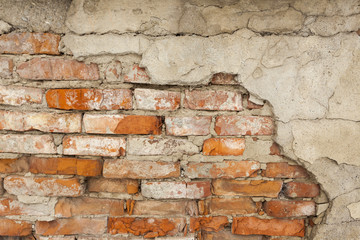 Damaged vintage brick wall