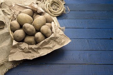 Potatoes over Blue Background