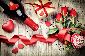 St Valentine's setting with red roses bouquet, present and red w