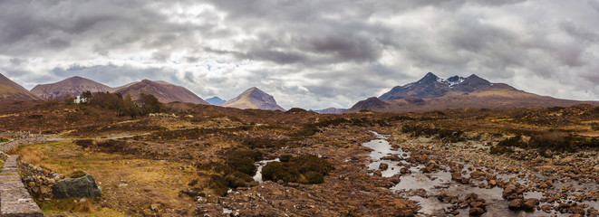 Wall Mural - Panoramic skyline of the Glamaig, the Sligachan and the Cuillin mountains on a cloudy day at Isle of Skye - Scotland, UK