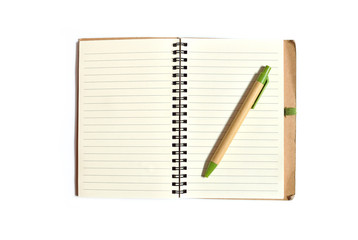 Note book with pen on a white background