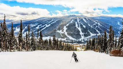 Wall Mural - Skiing down to the village of Sun Peaks in the Shuswap Highlands of central British Columbia, Canada