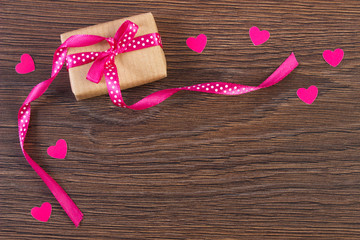 Wrapped gift with ribbon and hearts for Valentines Day, copy space for text
