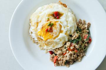 stir fried pork with basil leaf and deep fried egg, asian street