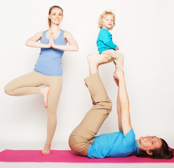 mother, father and son doing yoga