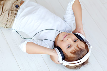 Happy boy are listening a music
