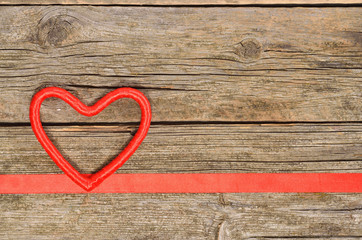 Decorative red heart and ribbon on wooden table. Top view, copy space. Valentines day concept