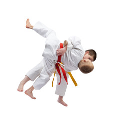 Athlete with a yellow belt is doing throw