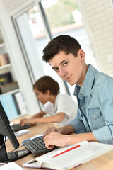 Portrait of teenager studying on desktop computer