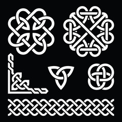 Celtic Irish knots, braids and patterns in white on black background
