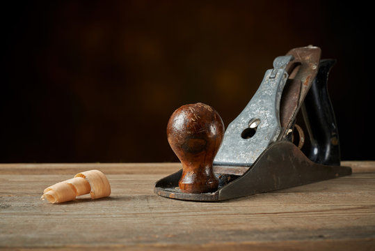 Hand plane on a wooden workbench.