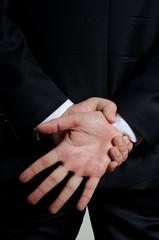 man in suti showing gesture
