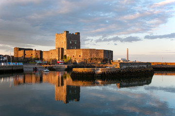 Carrickfergus Castle at sunset. One of the best preserved medieval structures in Northern Ireland
