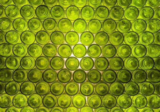 Pattern: wall formed by green bottles.