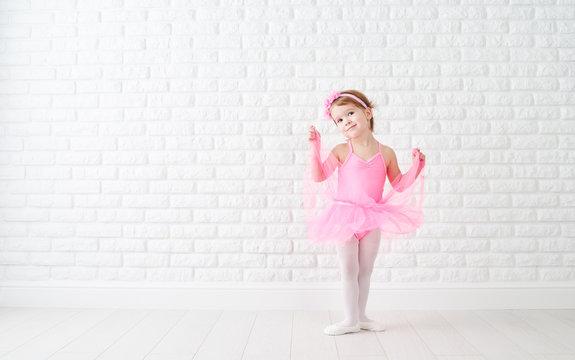 little child girl dreams of becoming  ballerina