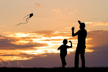 father and child with kite