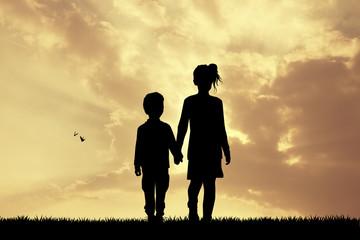 children silhouette at sunset
