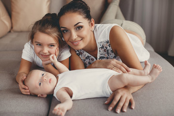 Portrait of a mother with two children at home