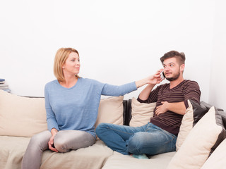 Couple with marriage problems on the sofa