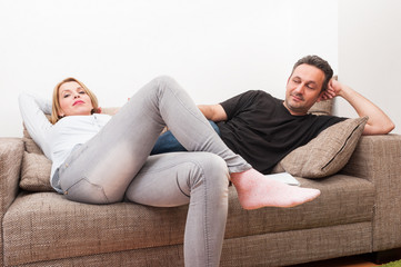 Couple sitting on the couch after a dispute