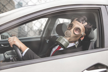 man driving with a gas mask