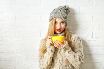 Lovely Hipster Woman in Winter Clothes with Cup