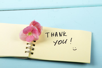 Thank You, flower, A spiral Notepad that has the words Thank You over a distressed wood turquoise background