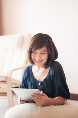 Young asian woman holding blank digital tablet.