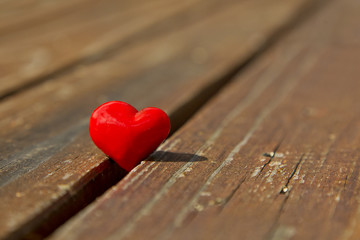 Red heart on a wooden surface
