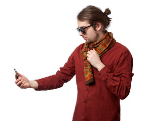 Man in red shirt and sunglasses making selfie