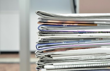 pile of newspaper at workplace