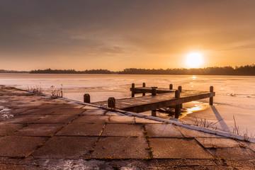 Wall Mural - Orange Winter landscape frozen lakewith ice